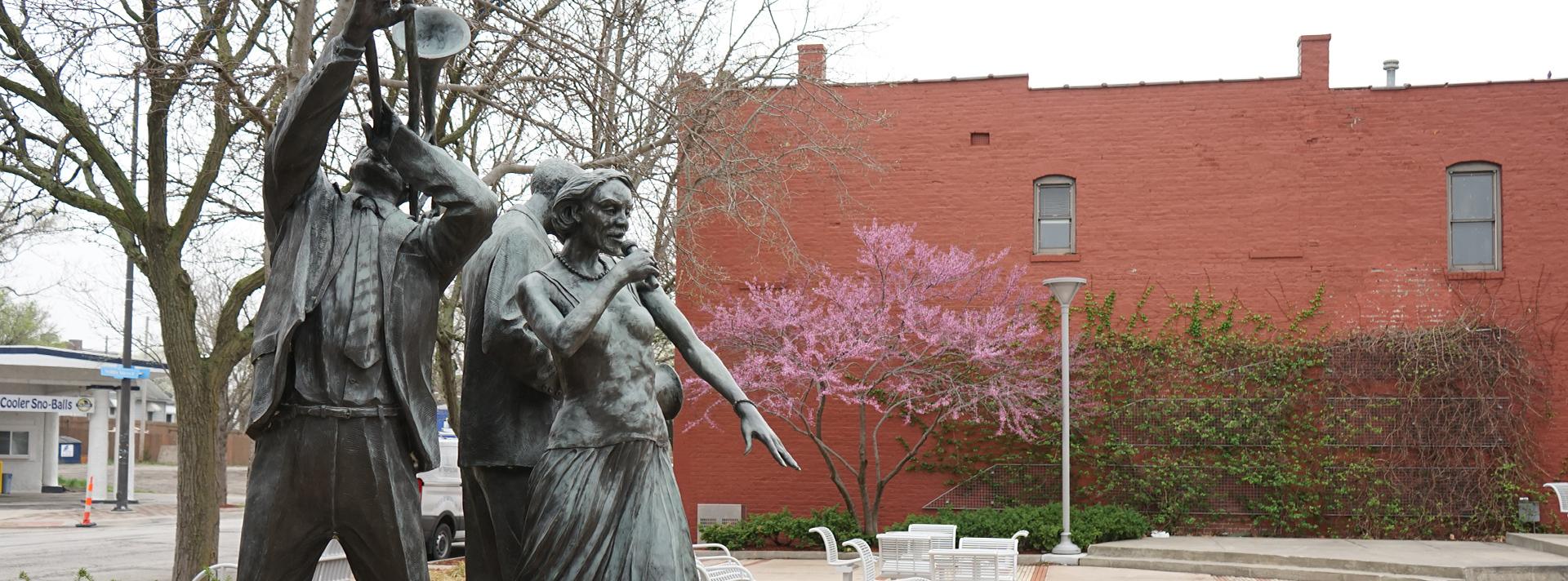 """The bronze statue """"Jazz Trio"""" Littleton Alston in North Omaha's Dreamland Park."""