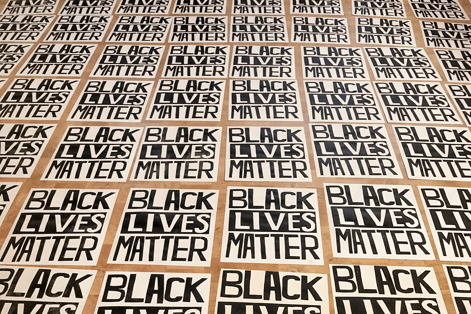 Hundreds of Black lives matter posters laying on the floor of the Wanda D Ewing gallery homepage