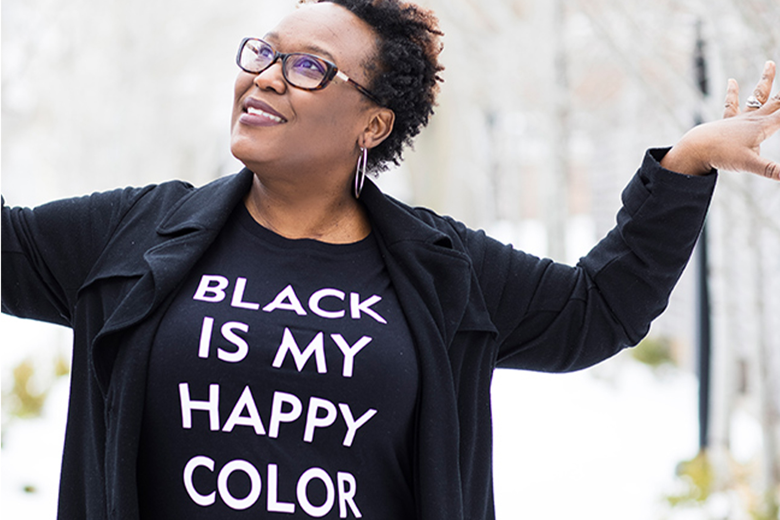 Portrait photo of Zedeka Poindexter standing inte snow wearing a t shirt that reads Black is my Happy Color landscape