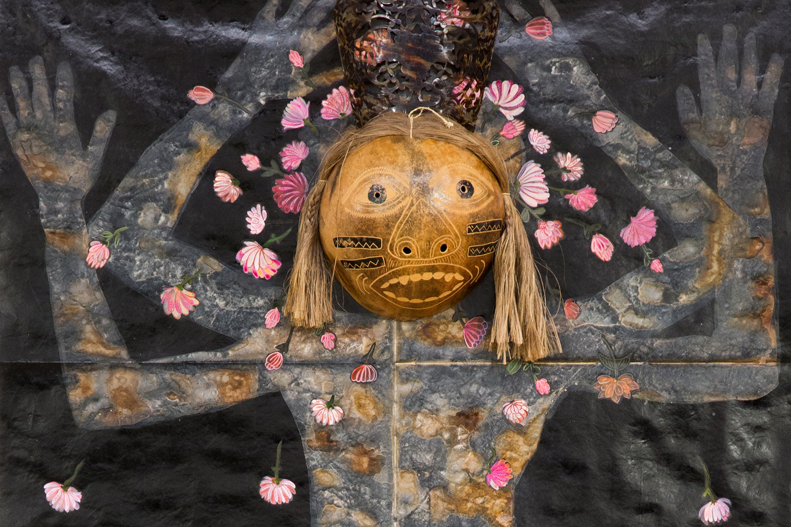 """Mixed media work of human figure from """"River"""" by Nancy Friedemann-Sánchez, featuring a carved wooden head and arms painted with flowers."""